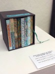 Hand made box of books, each by a separate student.