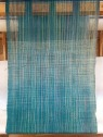 Like the warp, I transitioned the weft threads to create a subtle color change effect.