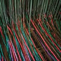Yarn through the heddles.