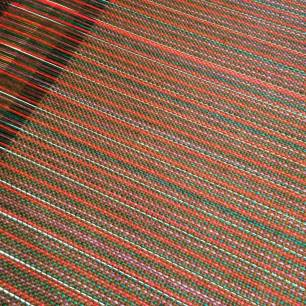 Fabric as its being woven on the loom.