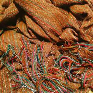Finished fabric off the loom, before wet-finishing and felting.