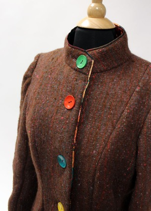 Rainbow buttons adorn the front of the jacket and give it a cheerful attitude