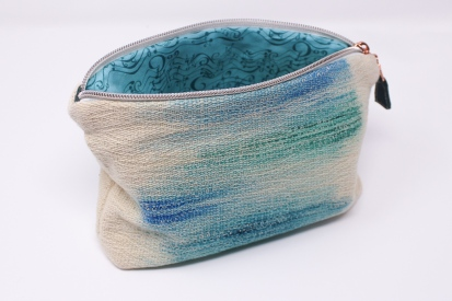 Handwoven zippered pouch.